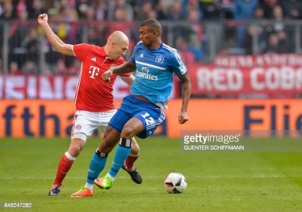 Bayern Munich's Dutch midfielder Arjen Robben and Hamburg's Brazilian midfielder Walace vie for the ball vie for the ball during the German first...