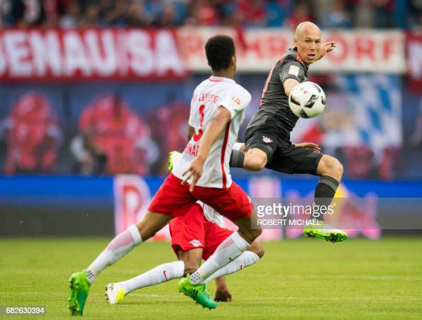 Bayern Munich's Dutch midfielder Arjen Robben and Leipzig's Brazilian defender Bernardo vie for the ball during the German first division Bundesliga...