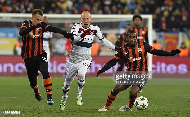 Bayern Munich's Dutch midfielder Arjen Robben and Shakhtar Donetsk's defender Vyacheslav Shevchuk and Shakhtar Donetsk's Brazilian midfielder...