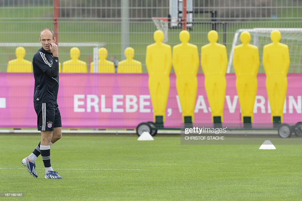 Bayern Munich's Dutch midfielder Arjen Robben arrives for the final team training ahead the UEFA Champions League semi final first leg football match between FC Bayern Munich and FC Barcelona at the trainings area in Munich, southern Germany, on April 22, 2013. The semi final match will take place on Tuesday evening, April 23, 2013.