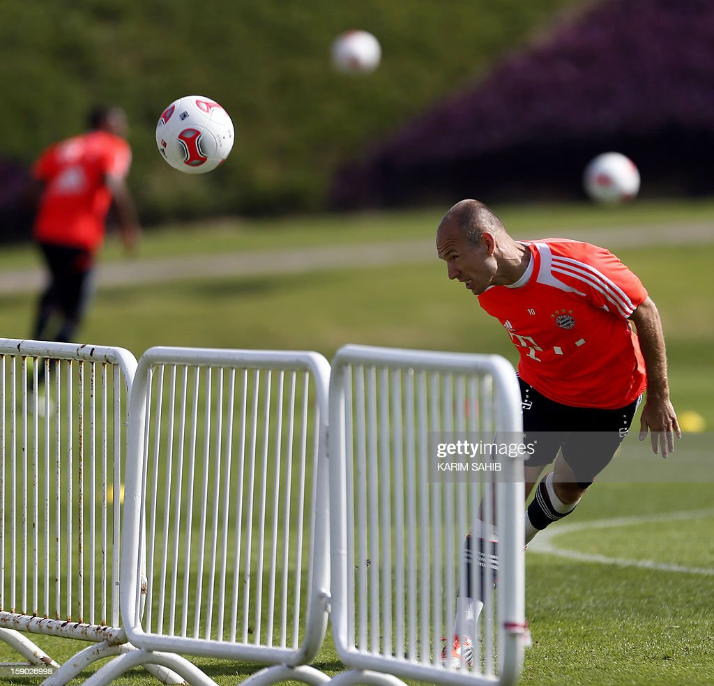 Bayern Munich's Dutch midfielder Arjen Robben (R) attends a training session at the Aspire Academy for Sports Excellence in Doha on January 6, 2013. Bayern Munich is in Qatar for a week-long training camp before the beginning of the new season of the German Bundesliga after the winter break.