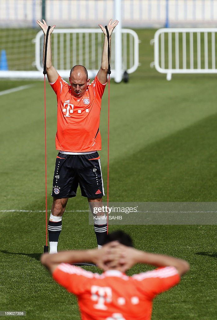 Bayern Munich's Dutch midfielder Arjen Robben (back) attends a training session at the Aspire Academy for Sports Excellence in Doha on January 6, 2013. Bayern Munich is in Qatar for a week-long training camp before the beginning of the new season of the German Bundesliga after the winter break.
