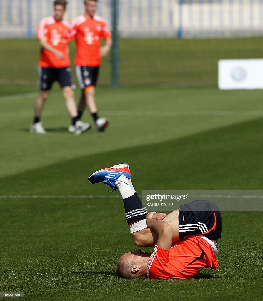 Bayern Munich's Dutch midfielder Arjen Robben (front) attends a training session at the Aspire Academy for Sports Excellence in Doha on January 6, 2013. Bayern Munich is in Qatar for a week-long training camp before the beginning of the new season of the German Bundesliga after the winter break.
