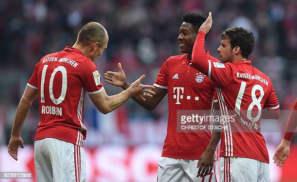 Bayern Munich's Dutch midfielder Arjen Robben Bayern Munich's Austrian defender David Alaba and Bayern Munich's Spanish defender Juan Bernat...