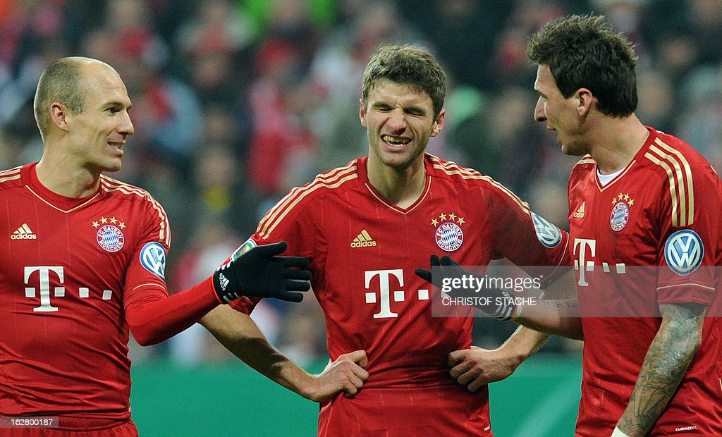 Bayern Munich's Dutch midfielder Arjen Robben, Bayern Munich's striker Thomas Mueller and Bayern Munich's Croatian striker Mario Mandzukic react during the German Cup quarter-final football match FC Bayern Munich vs Borussia Dortmund in Munich, southern Germany, on February 27, 2013. AFP PHOTO / CHRISTOF STACHE DURING THE MATCH AND PROHIBITS MOBILE (MMS) USE DURING AND FOR FURTHER TWO HOURS AFTER THE MATCH. FOR MORE INFORMATION CONTACT DFL.
