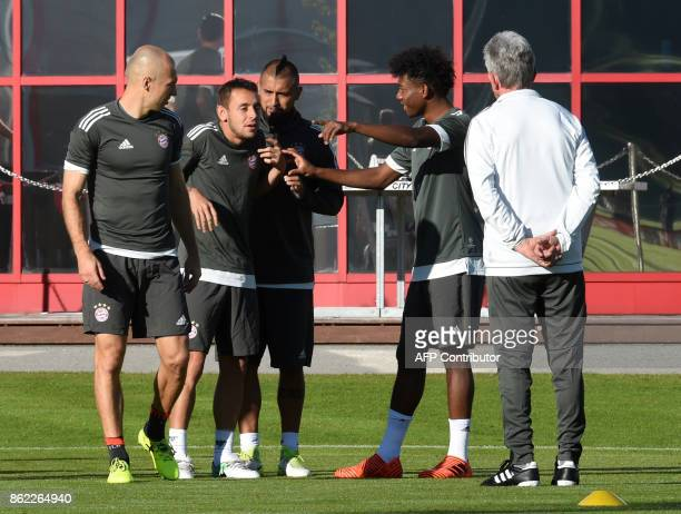 Bayern Munich's Dutch midfielder Arjen Robben Brazilian defender Rafinha Chilian midfielder Arturo Vidal and Austrian defender David Alaba joke as...