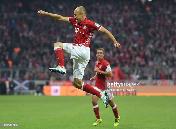 Bayern Munich's Dutch midfielder Arjen Robben celebrate after scoring the 30 goal during the German first division Bundesliga football match between...