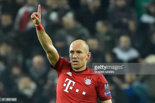 Bayern Munich's Dutch midfielder Arjen Robben celebrates after scoring a goal during the UEFA Champions League round of 16 first leg football match...