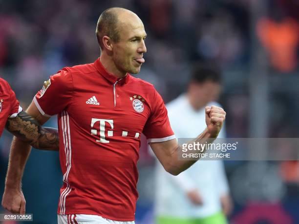 Bayern Munich's Dutch midfielder Arjen Robben celebrates after scoring the 10 during the German first division Bundesliga football match between FC...