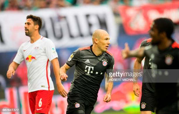 Bayern Munich's Dutch midfielder Arjen Robben celebrates after scoring the 45 during extra time of the German first division Bundesliga football...