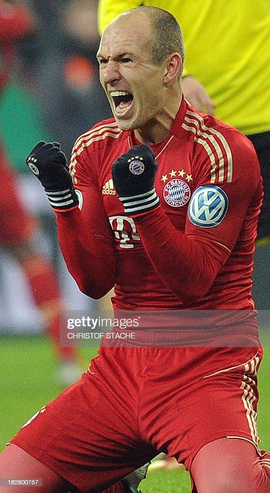 Bayern Munich's Dutch midfielder Arjen Robben celebrates after the German Cup quarter-final football match FC Bayern Munich vs Borussia Dortmund in Munich, southern Germany, on February 27, 2013. Bayern Munich won the match 1-0. AFP PHOTO / CHRISTOF STACHE DURING THE MATCH AND PROHIBITS MOBILE (MMS) USE