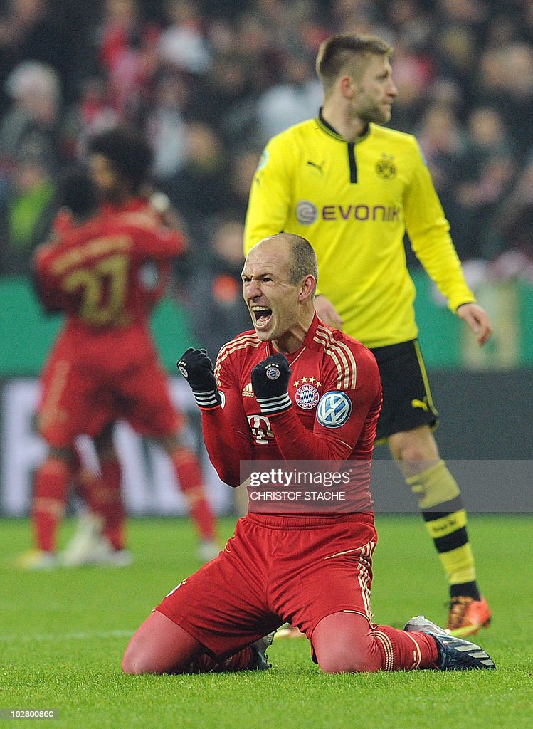 Bayern Munich's Dutch midfielder Arjen Robben celebrates after the German Cup quarter-final football match FC Bayern Munich vs Borussia Dortmund in Munich, southern Germany, on February 27, 2013. Bayern Munich won the match 1-0. AFP PHOTO / CHRISTOF STACHE DURING THE MATCH AND PROHIBITS MOBILE (MMS) USE DURING AND FOR FURTHER TWO HOURS AFTER THE MATCH. FOR MORE INFORMATION CONTACT DFL.