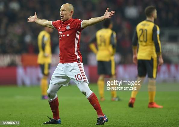 TOPSHOT Bayern Munich's Dutch midfielder Arjen Robben celebrates after the first goal during the UEFA Champions League round of sixteen football...