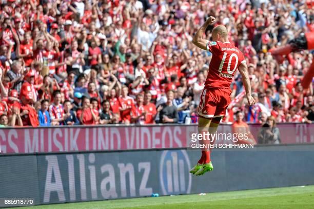 Bayern Munich's Dutch midfielder Arjen Robben celebrates his first goal during the German First division Bundesliga football match Bayern Munich vs...