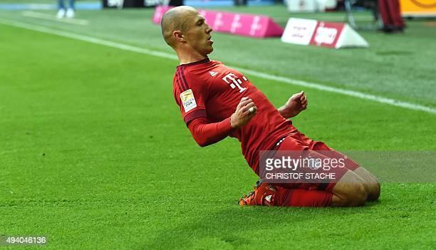 Bayern Munich's Dutch midfielder Arjen Robben celebrates scoring during the German first division football Bundesliga match between FC Bayern Munich...