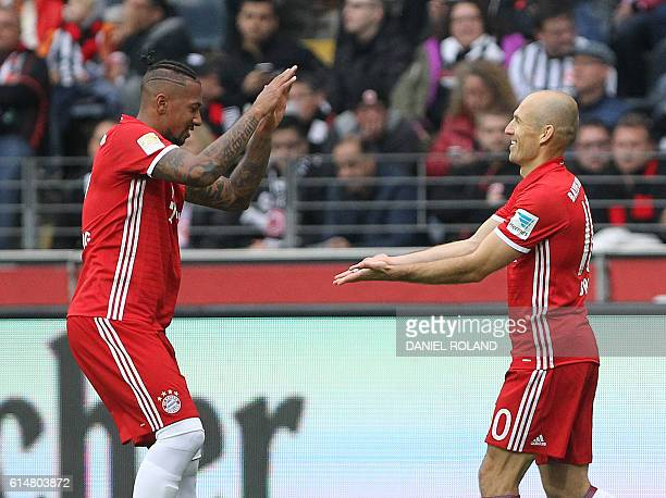 Bayern Munich's Dutch midfielder Arjen Robben celebrates scoring the 10 with Bayern Munich's defender Jerome Boateng during the German first division...