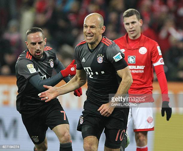 Bayern Munich's Dutch midfielder Arjen Robben celebrates scoring the 21 goal with Bayern Munich's French midfielder Franck Ribery during the German...