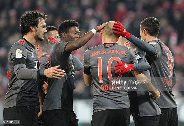 Bayern Munich's Dutch midfielder Arjen Robben celebrates scoring the 21 goal with his teammates during the German first division Bundesliga football...