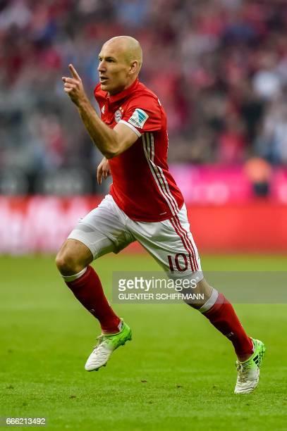 Bayern Munich's Dutch midfielder Arjen Robben celebrates scoring during the German first division Bundesliga football match FC Bayern Munich v BVB...
