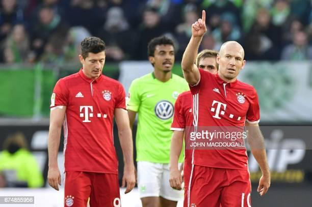 TOPSHOT Bayern Munich's Dutch midfielder Arjen Robben celebrates scoring the 40 during the German first division Bundesliga football match between...
