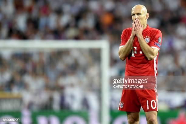 Bayern Munich's Dutch midfielder Arjen Robben geatures during the UEFA Champions League quarterfinal second leg football match Real Madrid vs FC...