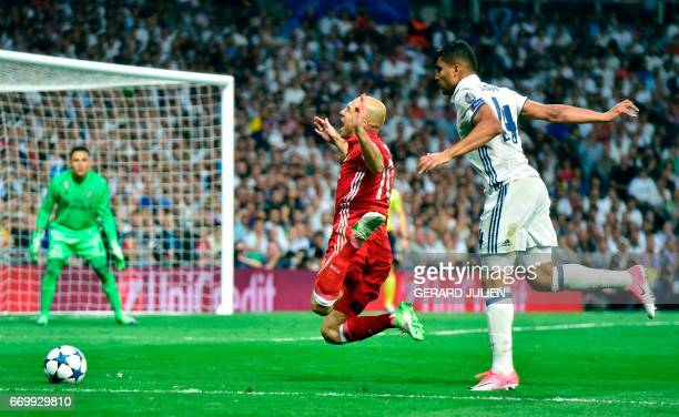 Bayern Munich's Dutch midfielder Arjen Robben is fouled by Real Madrid's Brazilian midfielder Casemiro during the UEFA Champions League quarterfinal...