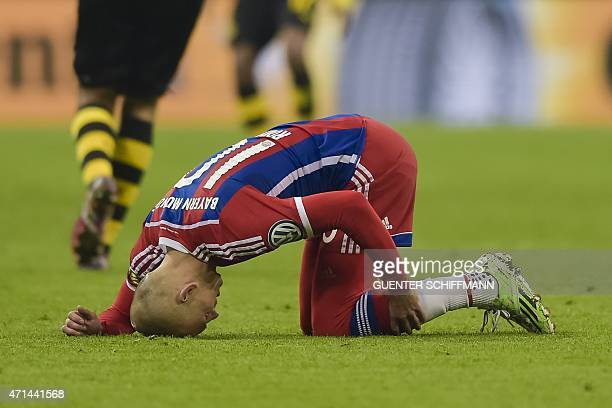 Bayern Munich's Dutch midfielder Arjen Robben is injured and has to go off during the German Cup DFB Pokal semifinal football match FC Bayern Munich...