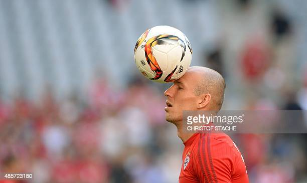 Bayern Munich's Dutch midfielder Arjen Robben juggles with the ball during the warm up ahead the German first division Bundesliga football match...