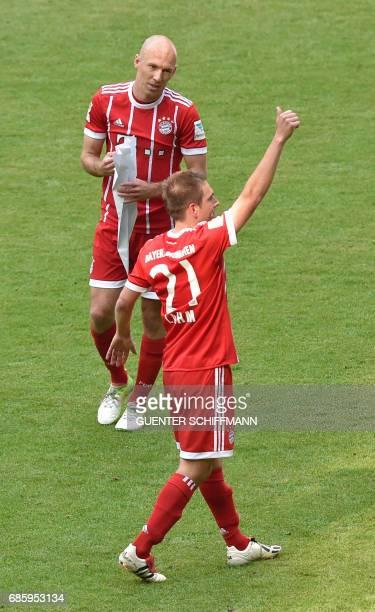 Bayern Munich's Dutch midfielder Arjen Robben looks at Bayern Munich's defender Philipp Lahm greeting fans after the German First division Bundesliga...