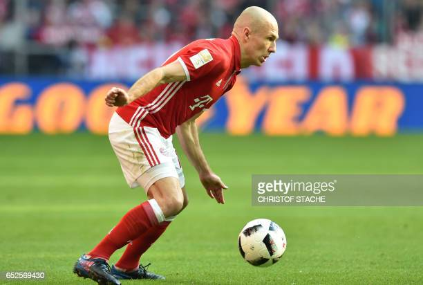 Bayern Munich's Dutch midfielder Arjen Robben plays the ball during the German First division Bundesliga football match Bayern Munich vs Eintracht...