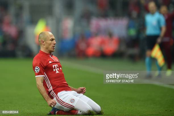 Bayern Munich's Dutch midfielder Arjen Robben reacts after the first goal during the UEFA Champions League round of sixteen football match between FC...