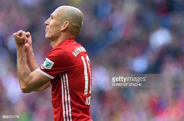 TOPSHOT Bayern Munich's Dutch midfielder Arjen Robben reacts during the German first division Bundesliga football match FC Bayern Munich v BVB...