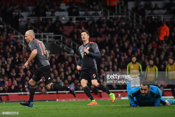 Bayern Munich's Dutch midfielder Arjen Robben scores past Arsenal's Colombian goalkeeper David Ospina during the UEFA Champions League last 16 second...