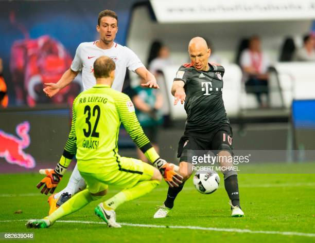 Bayern Munich's Dutch midfielder Arjen Robben scores the 45 against Leipzig's Hungarian goalkeeper Peter Gulacsi during extra time of the German...