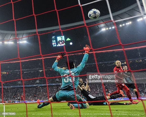 Bayern Munich's Dutch midfielder Arjen Robben scores the forth goal past Arsenal's Czech goalkeeper Petr Cech during the UEFA Champions League Group...