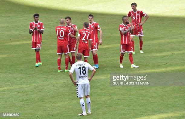 Bayern Munich's Dutch midfielder Arjen Robben thanks Bayern Munich's Spanish midfielder Xabi Alonso and Bayern Munich's defender Philipp Lahm after...