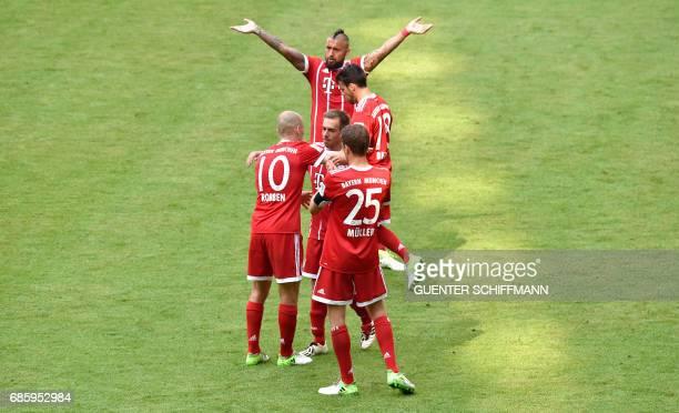 Bayern Munich's Dutch midfielder Arjen Robben thanks Bayern Munich's defender Philipp Lahm after the German First division Bundesliga football match...