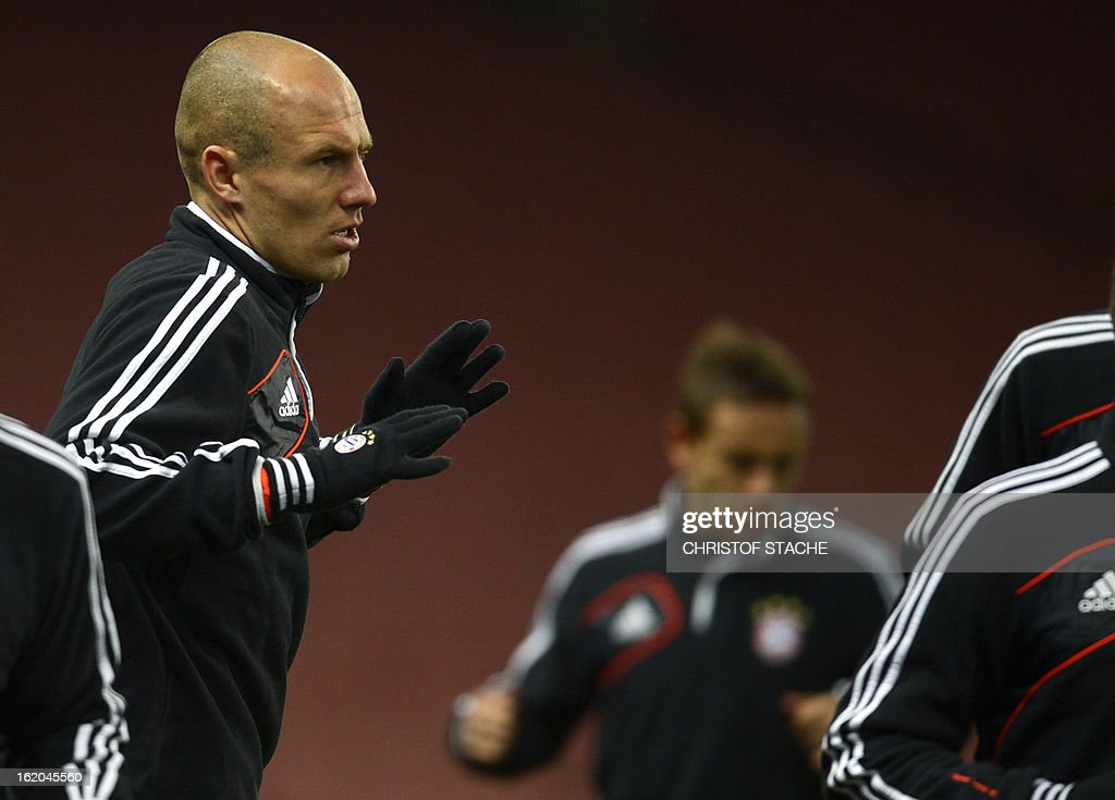 Bayern Munich's Dutch midfielder Arjen Robben warms up during a training session at the Emirates Stadium in north London on February 18, 2013 ahead of the forthcoming UEFA Champions League round of 16 football match between Arsenal and Bayern Munich. The match will take part at the Emirates stadium in London on February 19. AFP PHOTO / CHRISTOF STACHE