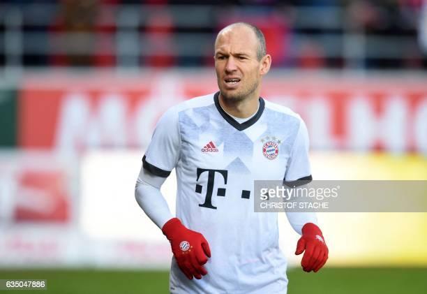 Bayern Munich's Dutch midfielder Arjen Robben warms up prior the German First division Bundesliga football match between FC Ingolstadt 04 and Bayern...
