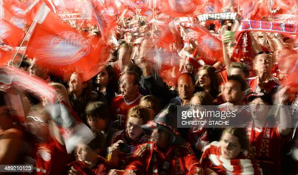 Bayern Munich's fans celebrate the team's German football league champion's title on May 10 2014 on the Marienplatz square in Munich after the German...