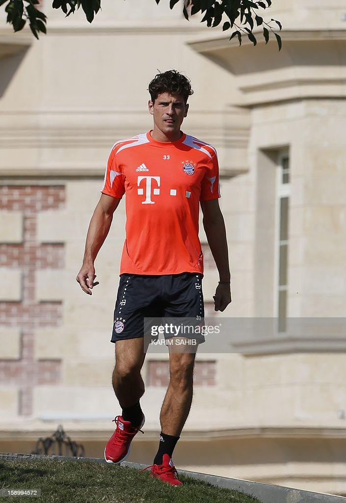 Bayern Munich's forward Mario Gomez arrives at the Aspire Academy for Sports Excellence in Doha for a football training session on January 5, 2013. Bayern Munich is in Qatar for a week-long training camp before the beginning of the new season of the German Bundesliga after the winter break. AFP PHOTO/KARIM SAHIB