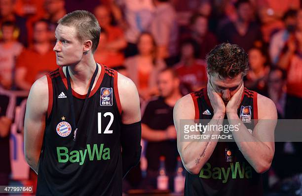Bayern Munich's forward Robin Benzing and Bayern Munich's guard Lucca Staiger reacts during the winner ceremony after the fifth final play off...