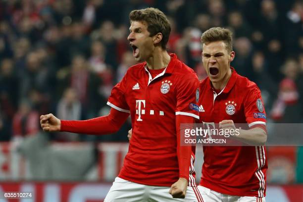 Bayern Munich's forward Thomas Mueller celebrate scoring the 51 goal with Bayern Munich's midfielder Joshua Kimmich during the UEFA Champions League...