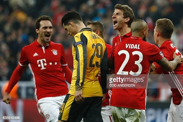 TOPSHOT Bayern Munich's forward Thomas Mueller celebrate scoring the 51 goal during the UEFA Champions League round of sixteen football match between...