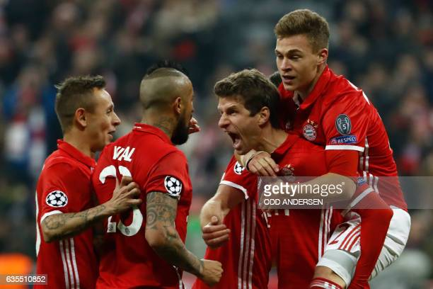 TOPSHOT Bayern Munich's forward Thomas Mueller celebrate scoring the 51 goal with his teammates during the UEFA Champions League round of sixteen...