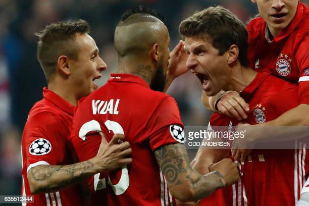 Bayern Munich's forward Thomas Mueller celebrate scoring the 51 goal with his teammates during the UEFA Champions League round of sixteen football...