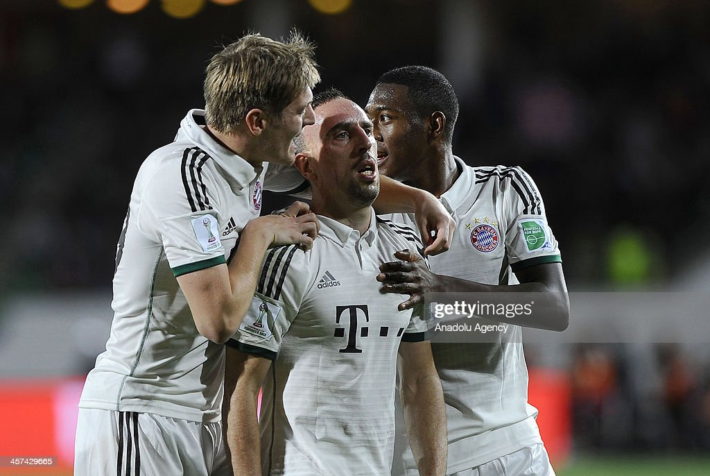 FC Bayern Munichs Franck Ribery (C) celebrates with his teammates Toni Kroos (L) and David Alaba (R) after scoring a goal during the FIFA Club World Cup 2013 soccer match between FC Bayern Munich and Guangzhou Evergrande FC on December 2013 in Agadir, Morocco.