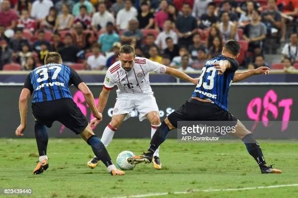 Bayern Munich's Franck Ribery fights for the ball with Inter Milan's Milan Skriniar and Danilo D'Ambrosio during their International Champions Cup...