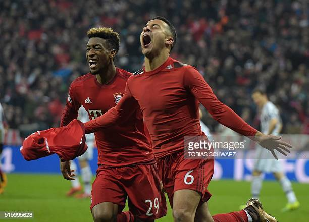 Bayern Munich's French defender Kingsley Coman reacts after scoring with Spanish midfielder Thiago Alcantara during extratime during the UEFA...