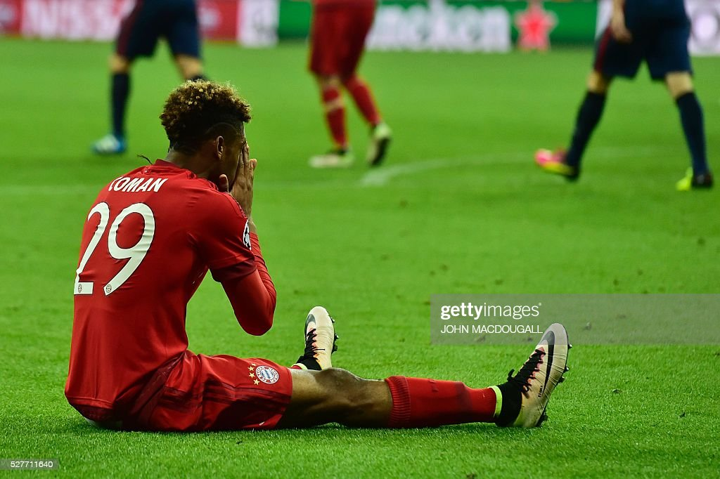 Bayern Munich's French defender Kingsley Coman reacts during the UEFA Champions League semi-final, second-leg football match between FC Bayern Munich and Atletico Madrid in Munich, southern Germany, on May 3, 2016. / AFP / John MACDOUGALL